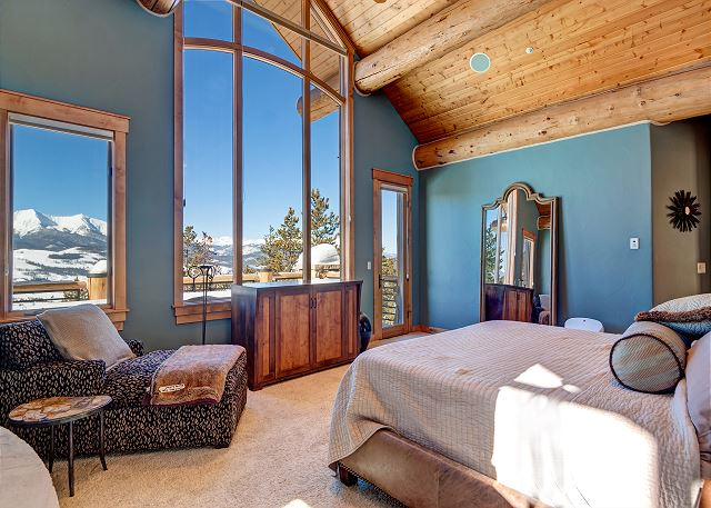 offers sweeping mountain views, a two-sided fireplace, and decorative paint style