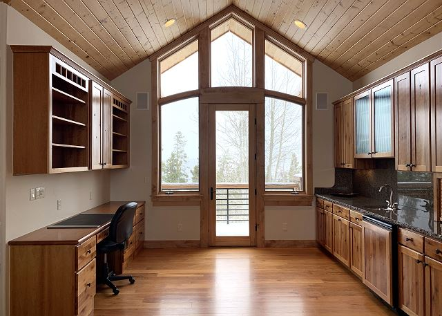 - Dishwasher, sink, coffee maker and desk with private deck access
