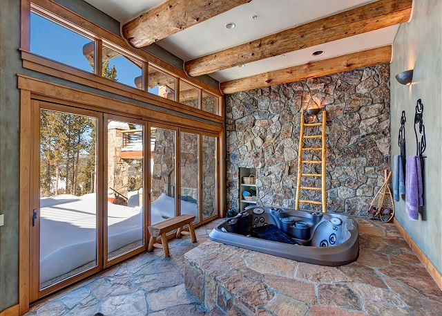 hot tub area with wall windows that fully open in summer months