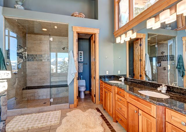 standing shower with steamer and dual sinks