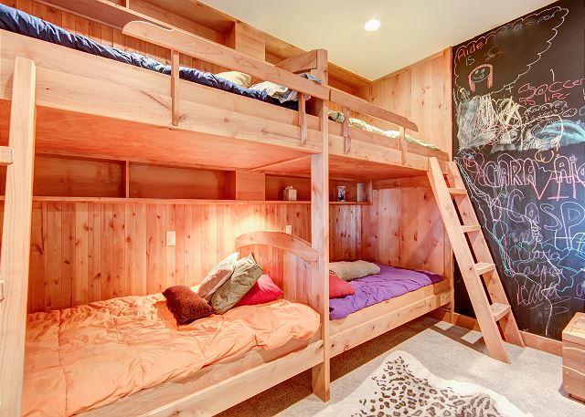 - sleeps 4 in two custom built full size bunks, ensuite full bathroom with tub