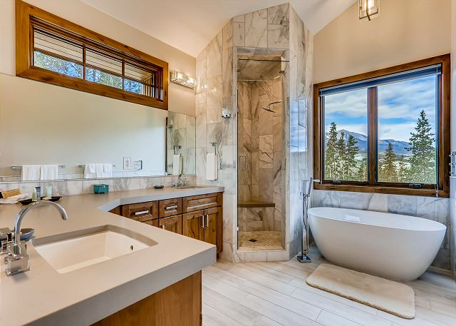 with dual sinks, shower and deep tub