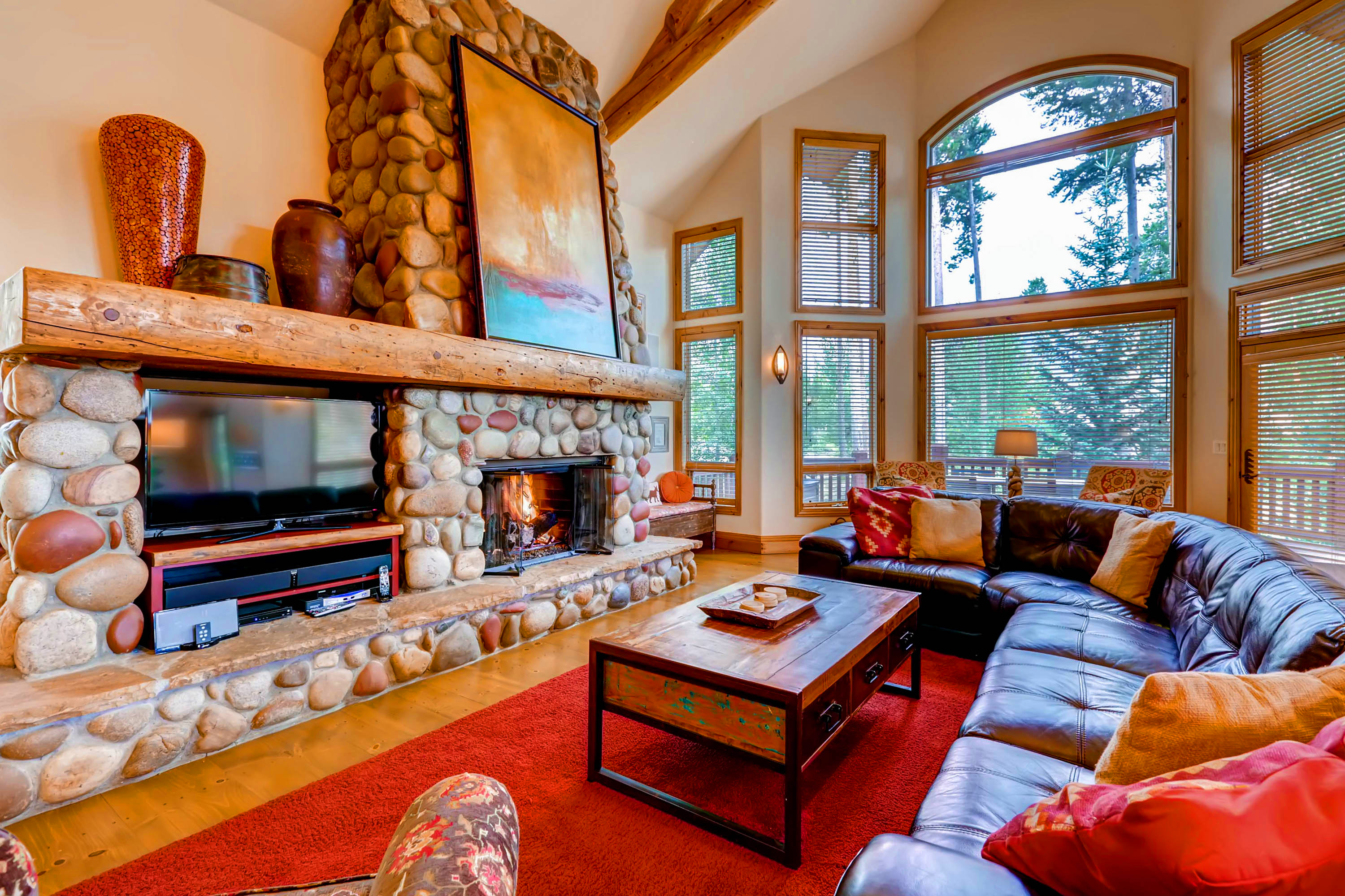 Inglenook Great Room With Large Windows In The Wintertime Enjoy Excellent Views Of Ski Resort Gas Fireplace And Flat Screen TV