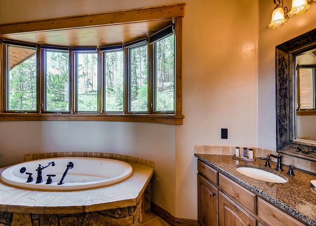with 2 vanities, large jetted tub and separate walk-in shower with dual shower heads