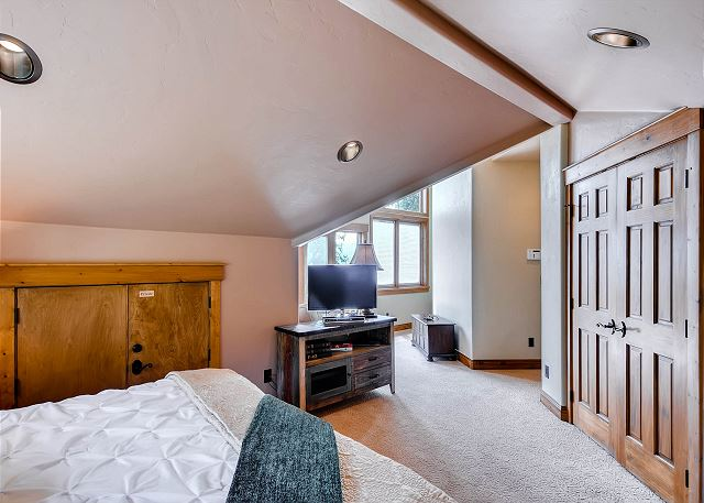 with king bed, TV, sitting area and private bath