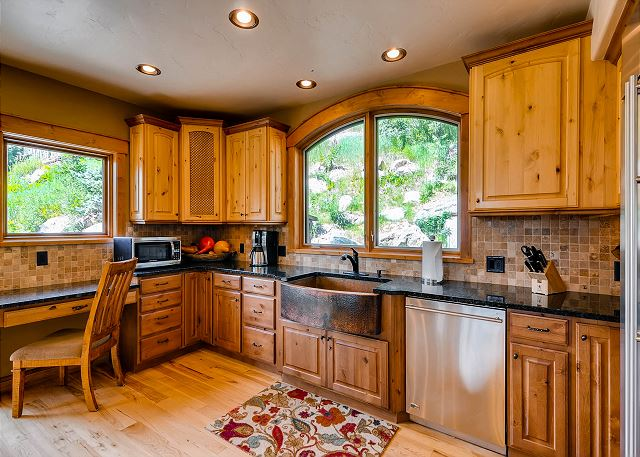 with stainless appliances and large farm sink