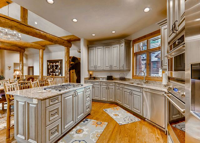 kitchen with a fully stocked supply of utensils, dishes, pots & pans, and more!