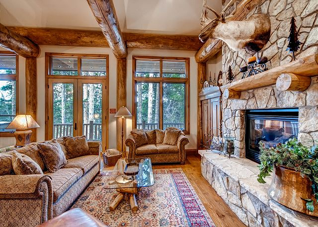 with Gas Fireplace and doors that lead out to deck with hot tub