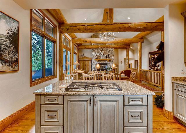 while overlooking the high log beams and open floorplan