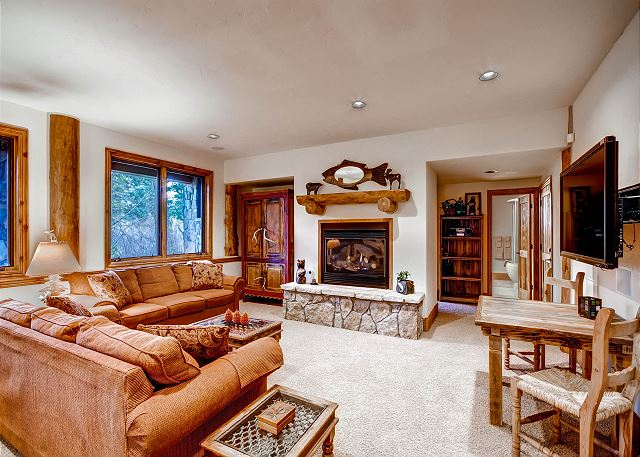 with gas fireplace, flatscreen TV and Billiards/Ping Pong Table