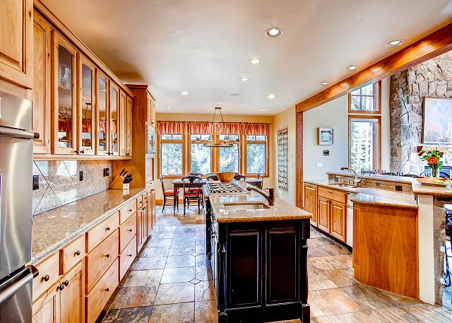 Kitchen with all high end appliances, two sinks, two dishwashers, breakfast bar and open to the Great Room