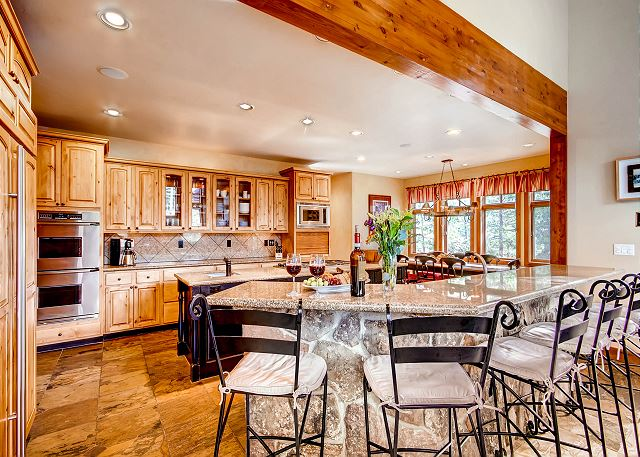 Expansive Kitchen with lots of workspace, high end appliances and kitchen breakfast bar