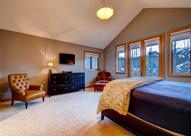 Upstairs Secondary King Suite – sleeps 2 in one king bed, private bath with steam shower and jetted tub, sitting area, French doors open to balcony