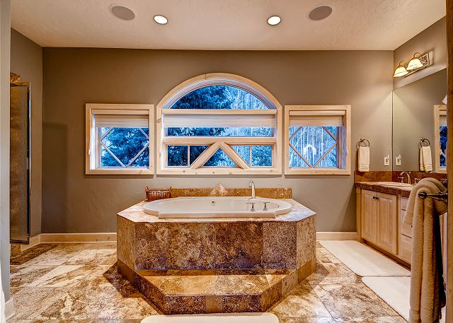 Upstairs Secondary King Suite private bath with steam shower and jetted tub