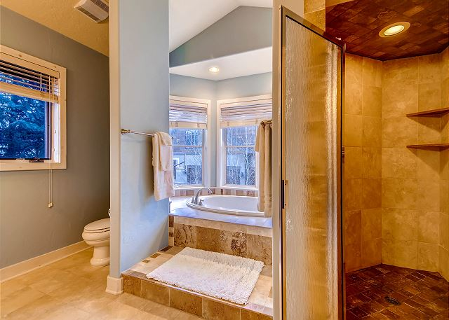 Main Level Exclusive King Suite Private Bath with Soaking Tub, Walk-in Shower and Two Sinks