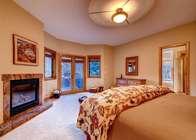 Main Level Exclusive King Suite – sleeps 2 in one king bed, sitting area with fireplace, private bath with shower and jetted tub, French doors open to deck and hot tub