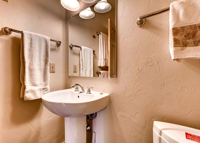 Convenient powder bath on main level to living area and kitchen