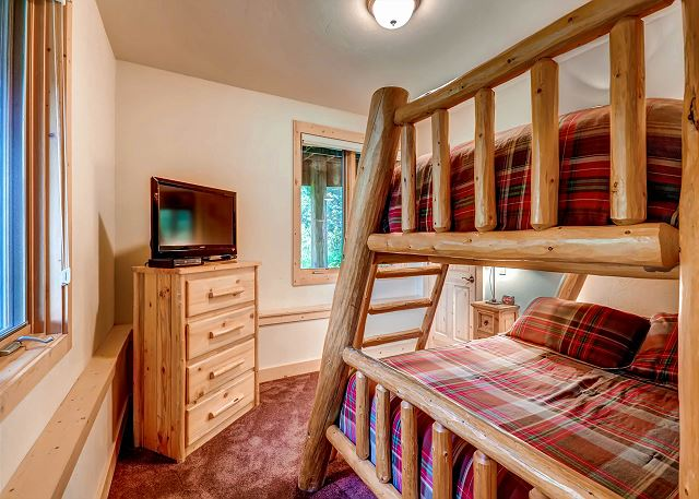 Spruce Room - sleeps 3-4 in a captain's bunk trundle (twin on top, twin trundle on pullout bottom, double (full) on lower bunk), exclusive hall bath