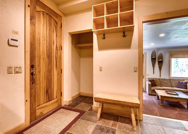 Entry from lower exterior and garage, includes cubby and hanging space for all your outdoor gear