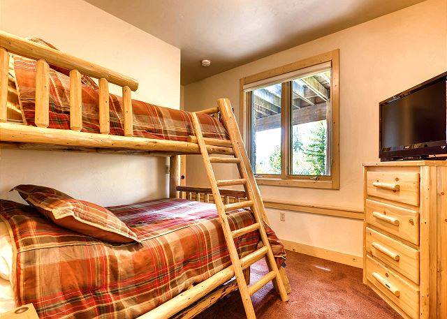Spruce Bunk - sleeps 3-4 in a captain's bunk trundle (twin on top, twin trundle on pull out bottom, double (full) on lower bunk)