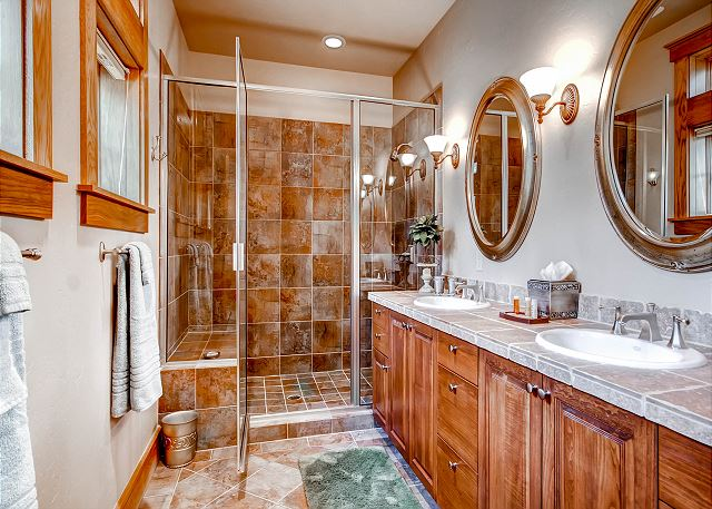 with two sinks and large walk in shower