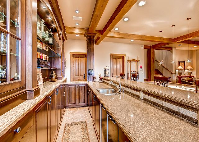 Bar in Lower Level Rec Room with Bar Sink, Dishwasher and Refrigerator