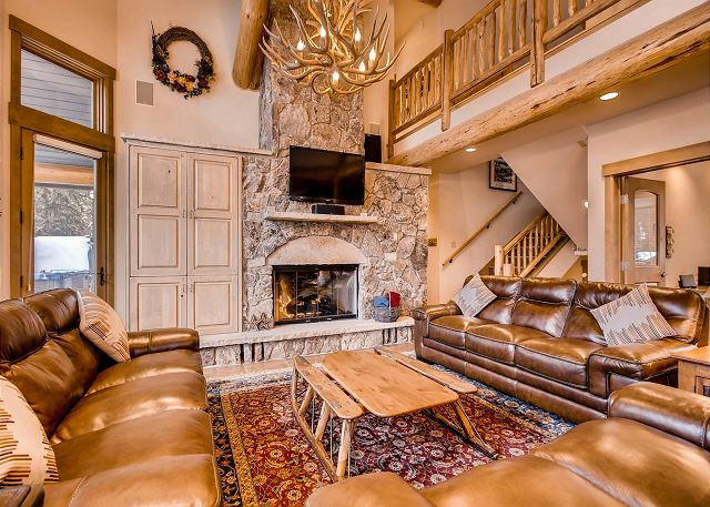 by fireside in this spacious and comfy living room
