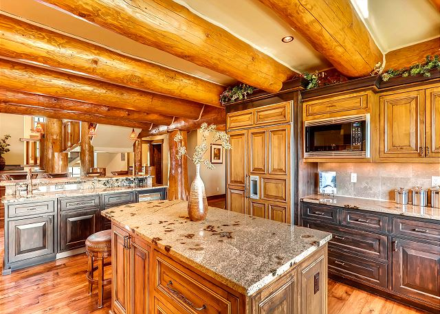 with two islands, bar seating & professional appliances