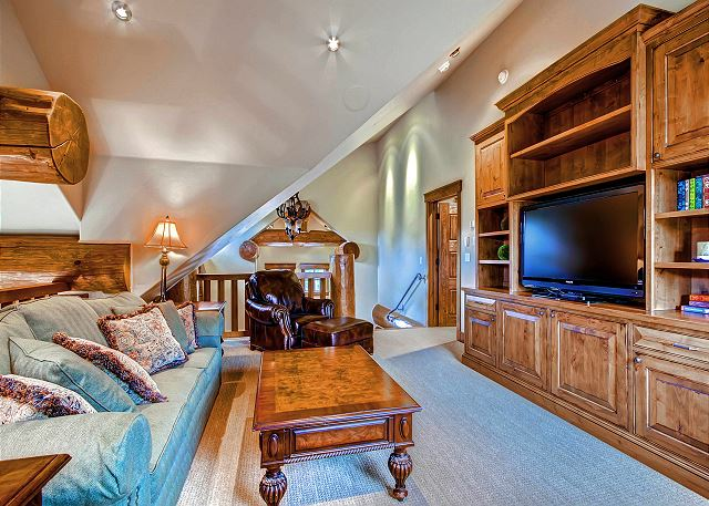 with Flat Screen TV and Queen Sleeper Sofa