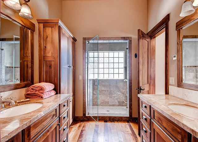 with two sinks and large walk-in steam shower