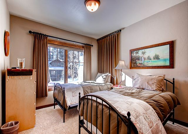 sleeps 2 in two twin beds, shares hall bath with EverGreen Queen