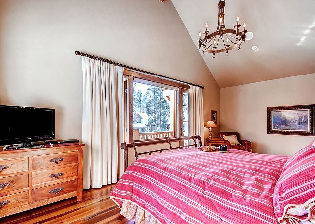 with king bed, TV, reading nook, private balcony and exceptional views of the ski area