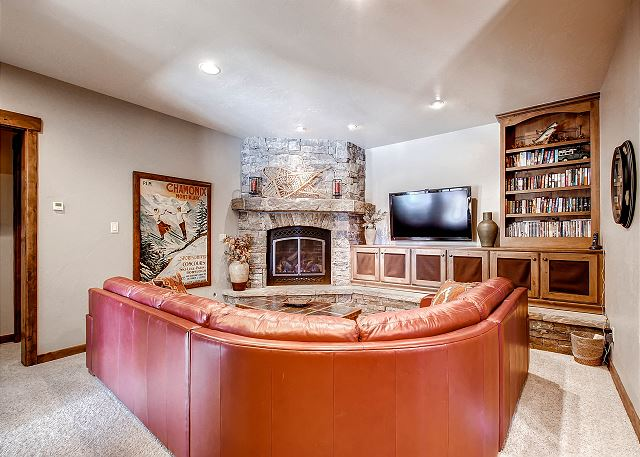 offers a nice quiet space with TV, gas fireplace and cozy seating