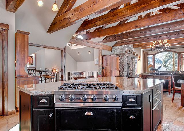 with six-burner gas cooktop on island