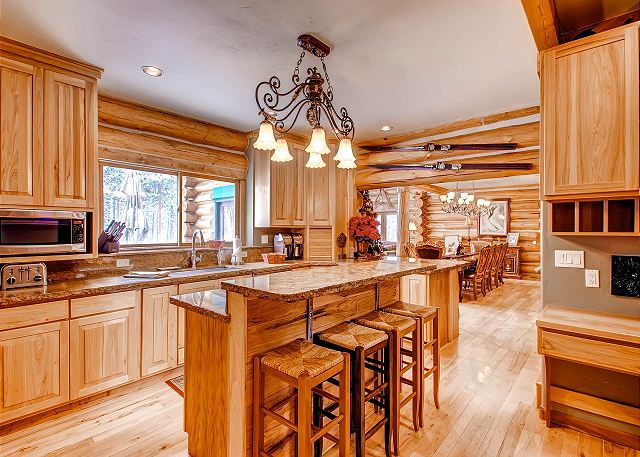main level kitchen with counter space and bar seating for 4