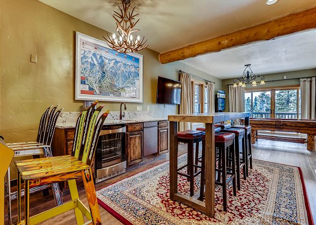 with wet bar, high top table seating, billiards, TV and arcade games