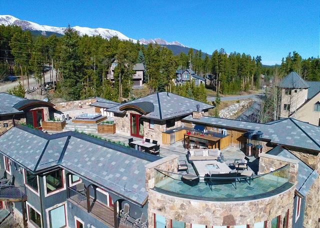 from this amazing rooftop patio complete with hot tub, flat screen TVs, glass fire-pit, kitchen and the best VIEWS in Colorado!