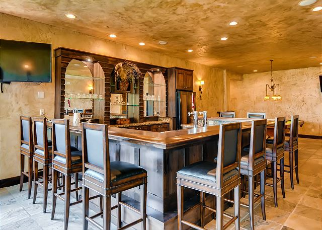 With TVs, Billiards and a cozy den with sofas - the perfect place to host an Apres Gathering!