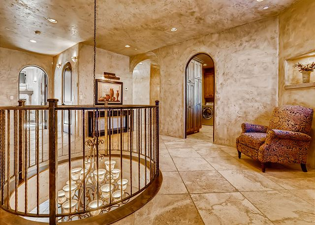 leads to all 5 Bedroom Suites, Secret Library, Laundry Room and stairway up to the Rooftop Level