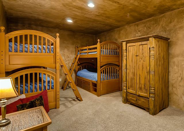 - Sleeps 4 in two sets of bunks, uses powder bath in hall