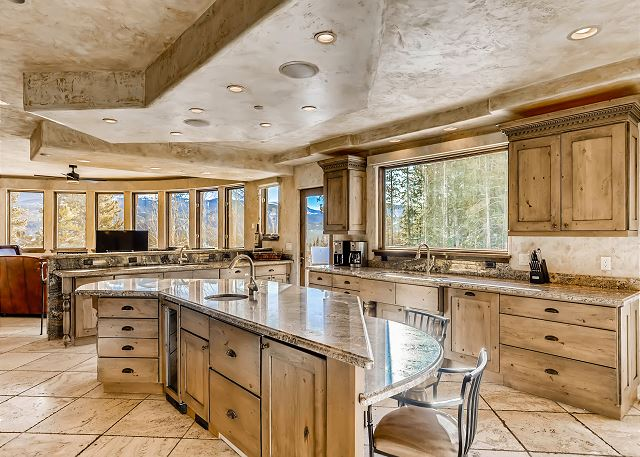 features multiple sinks, full sized refrigerator and freezer, 2 dishwashers, a Wolf gas range and panoramic mountain views