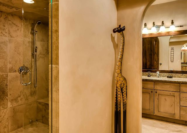 spacious walk-in steam shower, his and hers bathroom suites and large tub