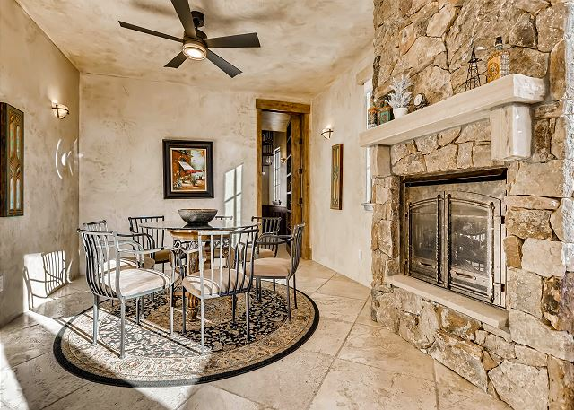 is adjacent to the Kitchen - the perfect place to sip on your morning coffee by the fire - or for the kids to dine in the evening!