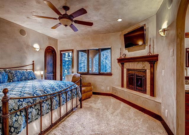 with king bed, gas fireplace, TV, balcony and ensuite bath
