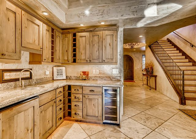 sits just outside the kitchen and features wine fridge, sink and plenty of space