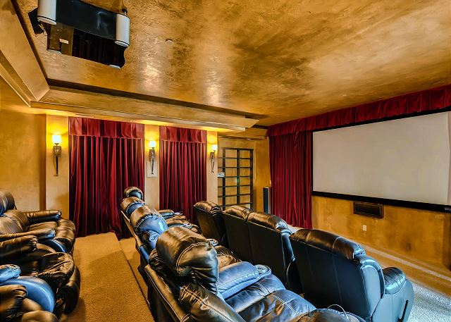 with comfy recliners and projection screen