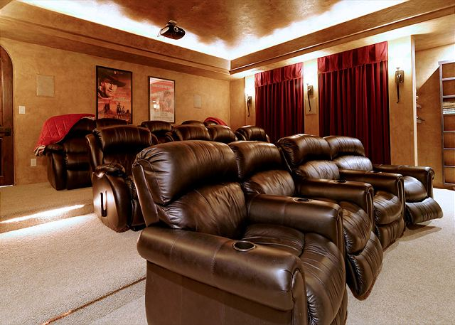 features a theatre room with seating in cozy recliners!
