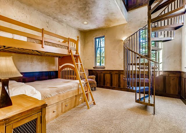 off of the Breakfast Nook, spiral staircase leads up to the library
