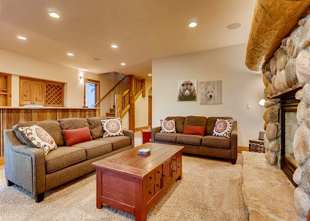 Fireplace, comfy couches and brightly lit