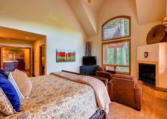 - king bed, ensuite bath with tub and separate shower. Bedroom features Cozy sitting area with Gas Fireplace and TV